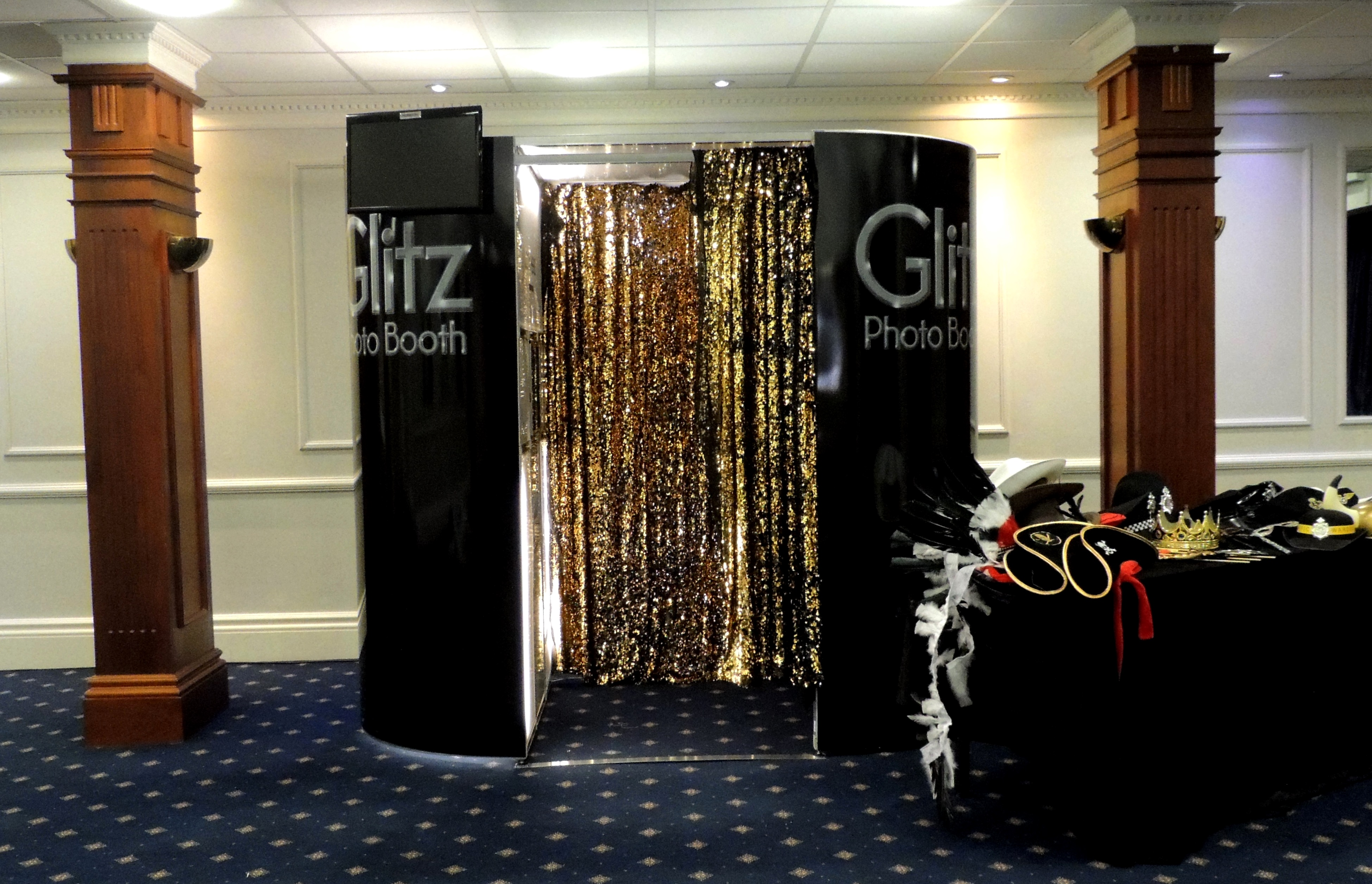Black Booth with Gold Curtains