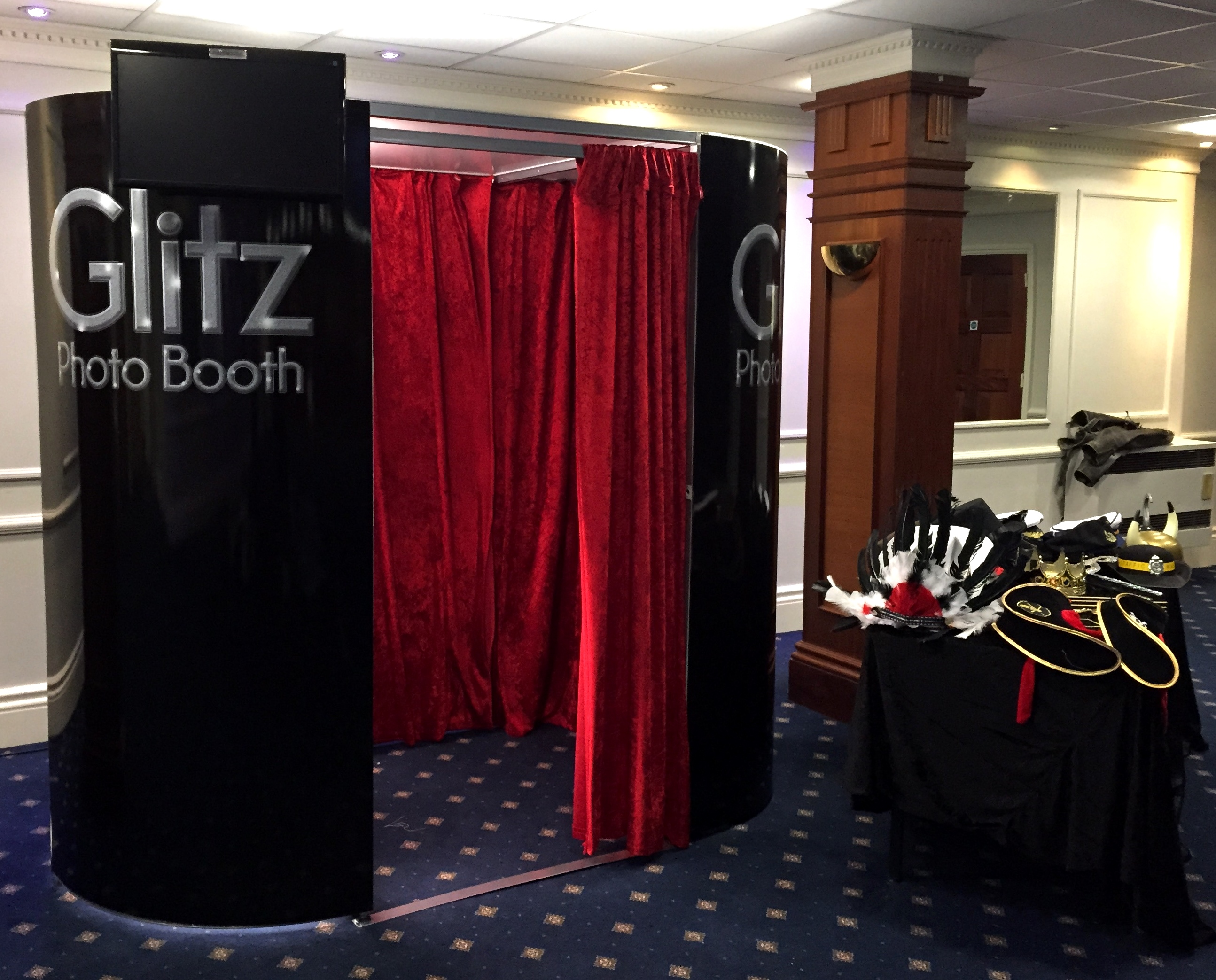 Black Booth with Red Curtains