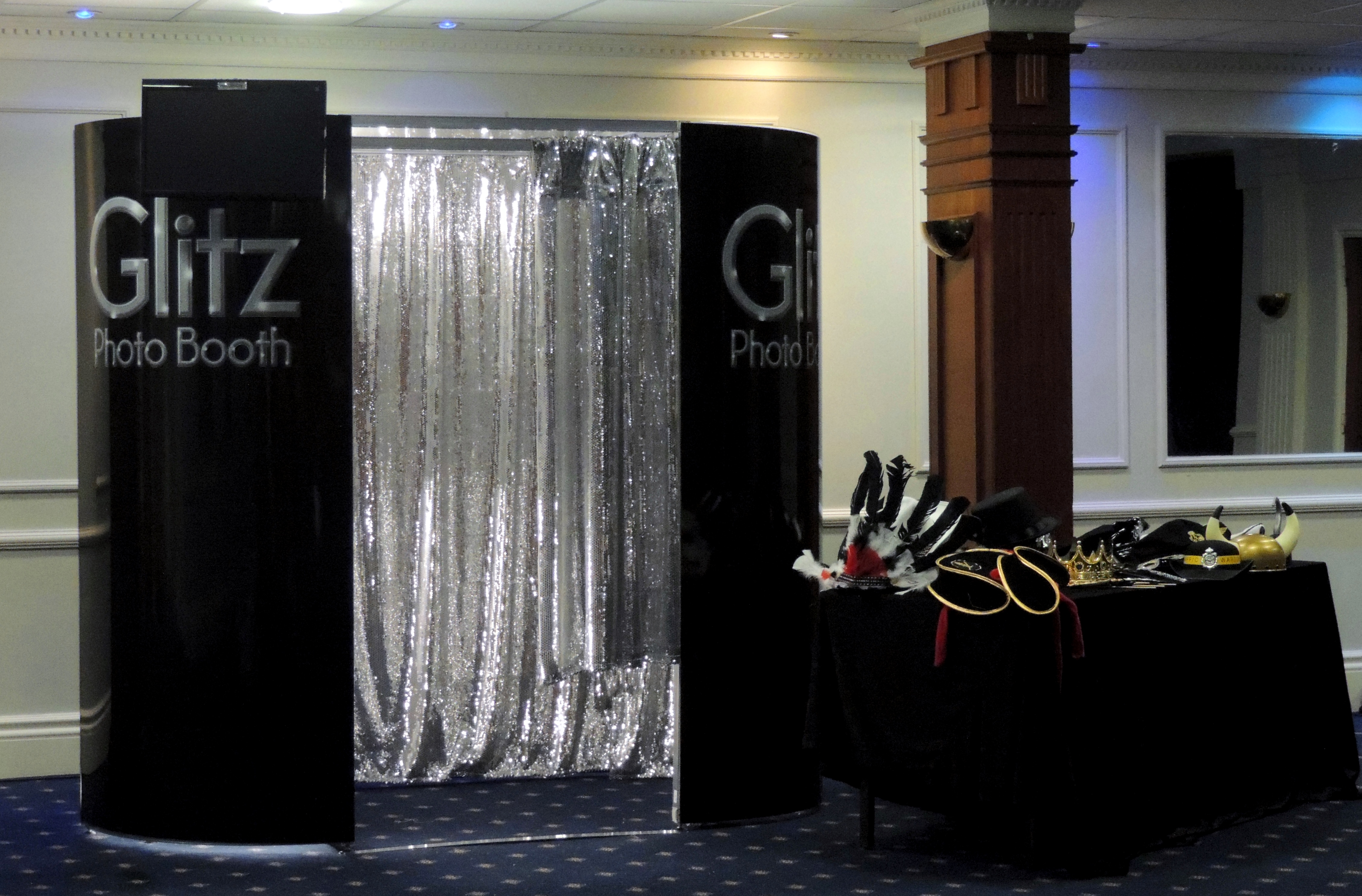 Black Booth with Silver Curtains