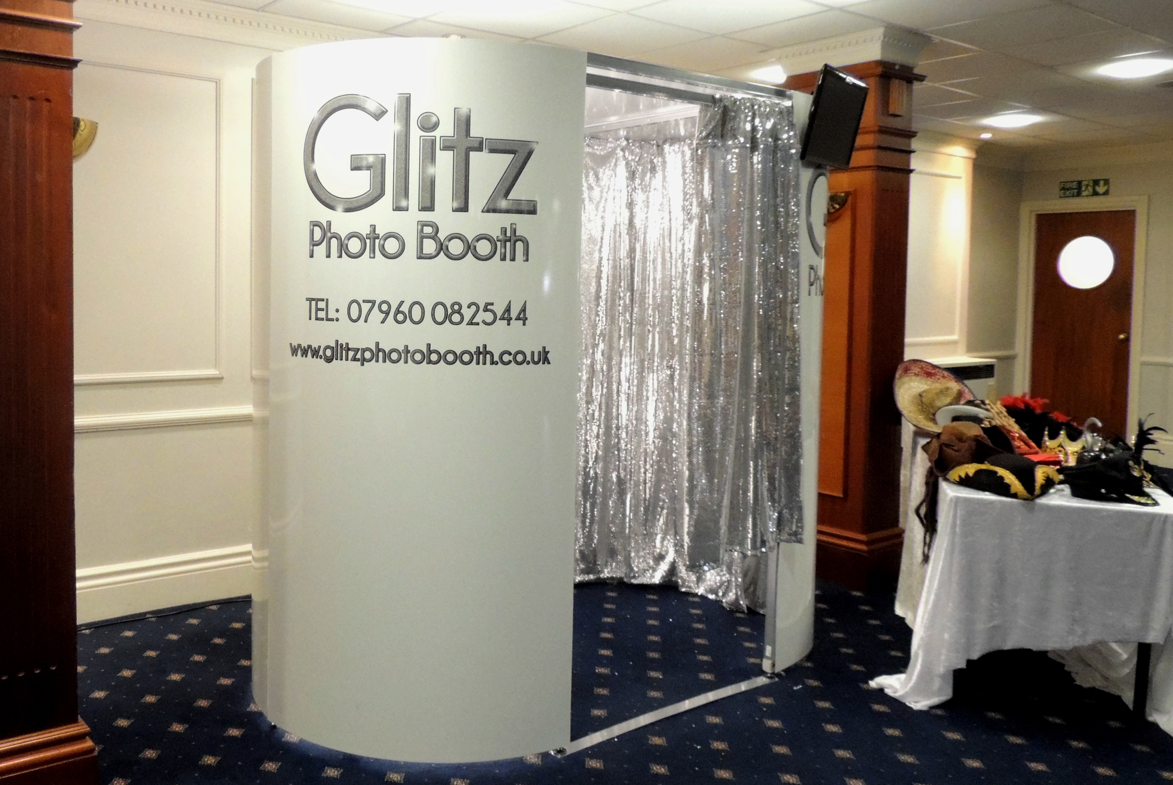 White Booth with Silver Curtains