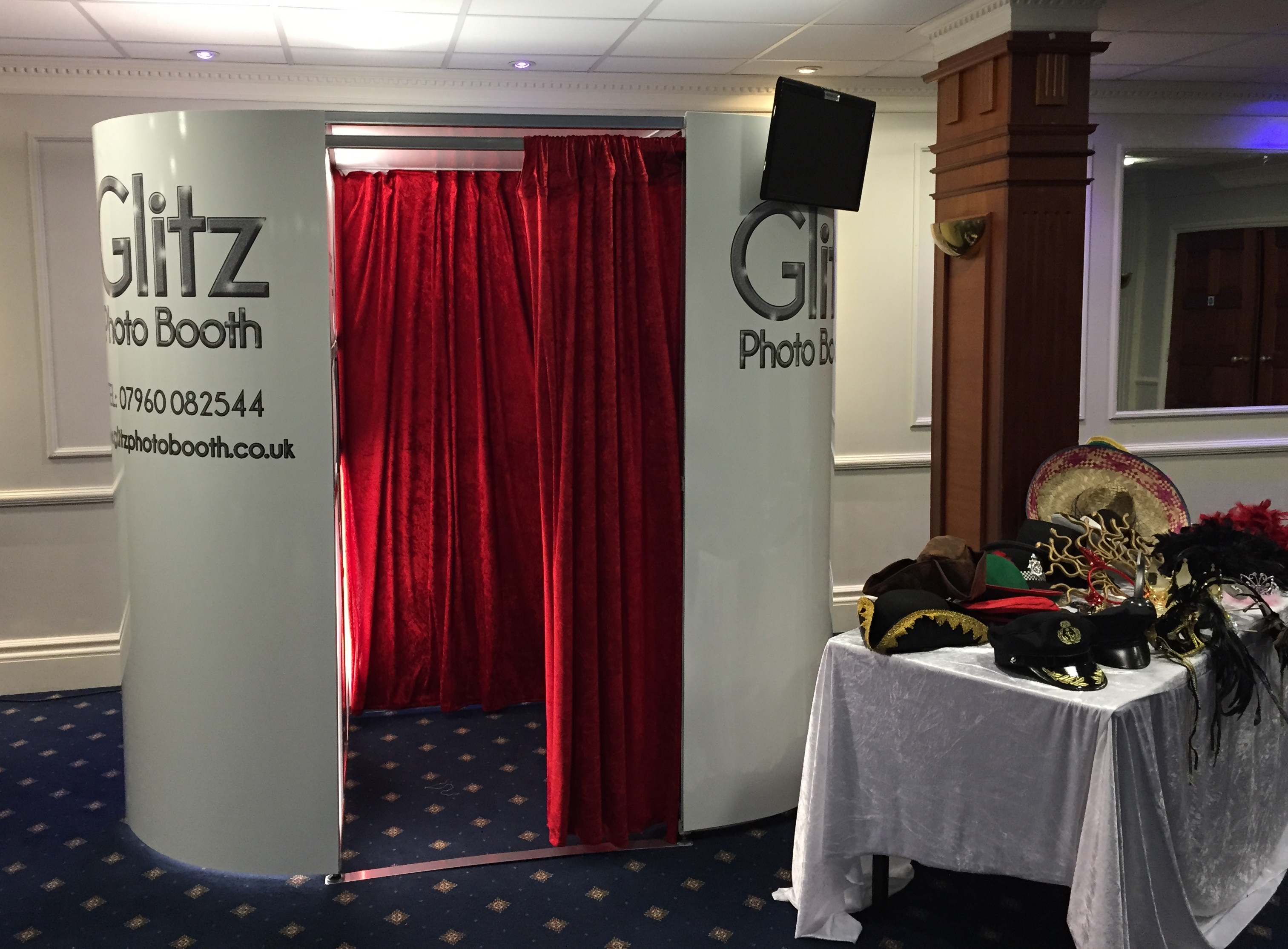 White booth with Red curtains